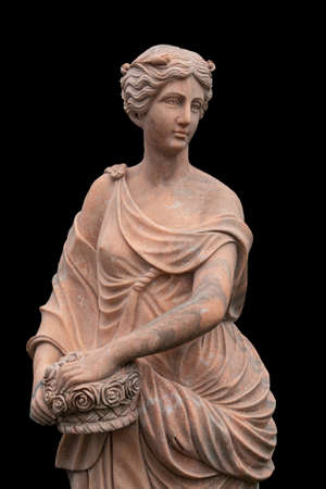 Clay statue of an ancient Greek goddess isolated on black background Imagens