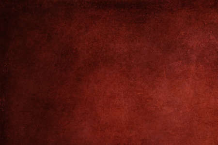 Abstract red stained paper texture background or backdrop. Empty old red paperboard or grainy cardboard for decorative design element. Simple monochrome surface for journal template presentation. 免版税图像