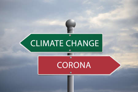 Crossroads sign symbolizing choice between climate breakdown and corona Stock fotó