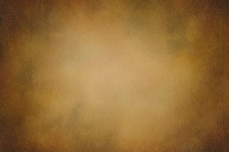 Texture for artwork and photography. Abstract dark yellow stained paper texture background or backdrop.