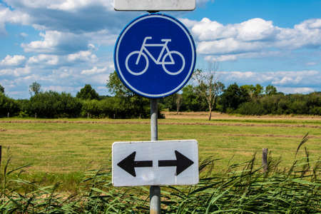 Road sign bicycle path in the Netherlands. Bicycle - traditional Dutch vehicle