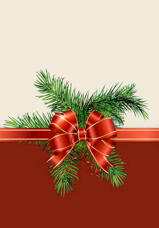 Christmas noble fir tree twigs and gift with red ribbon on beige paper background with copy space for text