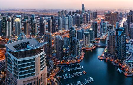 fantastic view: Fantastic view over illuminated architecture of a big city at night. Dubai Marina, United Arab Emirates. Scenic travel background. Stock Photo