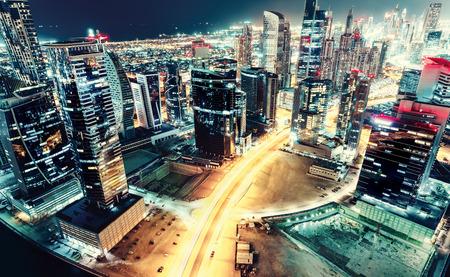 夜に大きな未来都市を空撮。ビジネス ・ ベイ, ドバイ, アラブ首長国連邦。夜間のスカイライン。ヴィンテージの効果。 写真素材