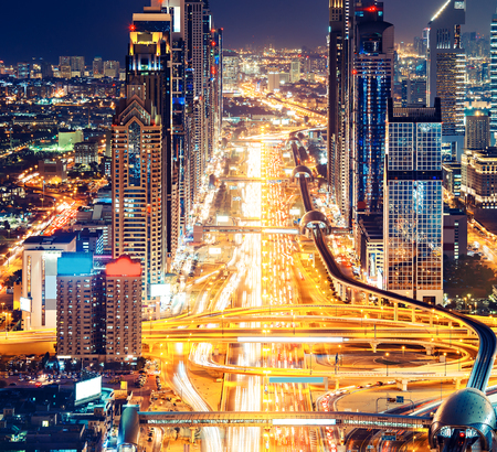 architectural firm: Downtown Dubai architecture by night. Aerial view of illuminated skyscrapers and big highway. Famous travel destination. Stock Photo