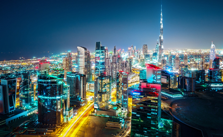 Fantastic nightime skyline of a big modern city. Downtown Dubai, United Arab Emirates. Colorful cityscape with skyscrapers.