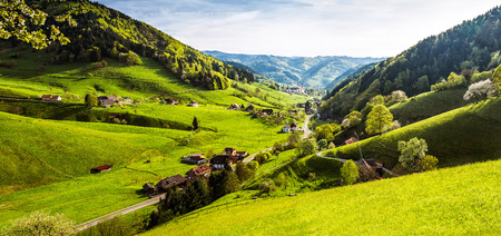 Scenic panorama view of a picturesque mountain village in Germany, Muenstertal, Black Forest.