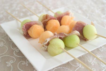 parma ham: Parma ham and melon balls on skewers Stock Photo