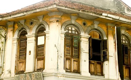 georgetown: The top storey of an old shophouse in historic Georgetown in Penang Stock Photo