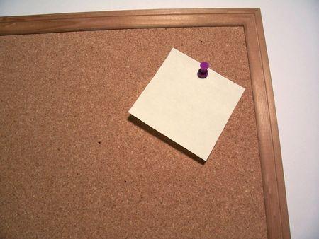 a sticky note on a corkboard