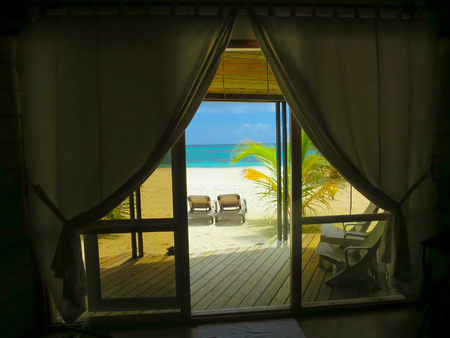 View from hotel room into paradise, Maldives - tropical heaven and peace.