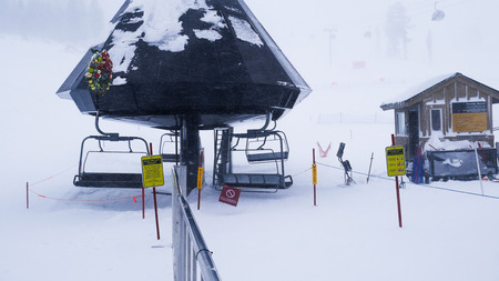 Chair lift closed due to snow storm and strong wind during the winter. Silence, no people at ski resort. Mammoth, California