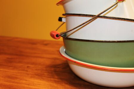 cheery: A cheery stack of vintage pots, pans and bowls Stock Photo