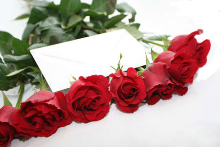 red roses bouquet with letter photo