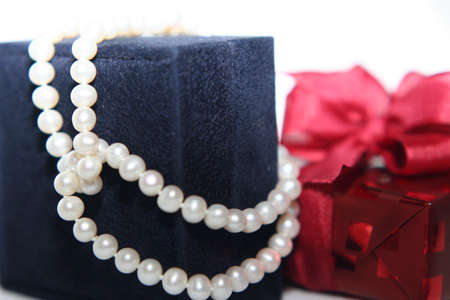 Womans gift with pearles in close up photo