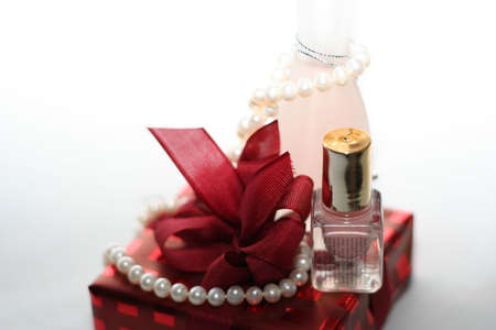 Womans gift with cosmetics in close up photo