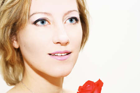 Lovely woman with red rose over white photo