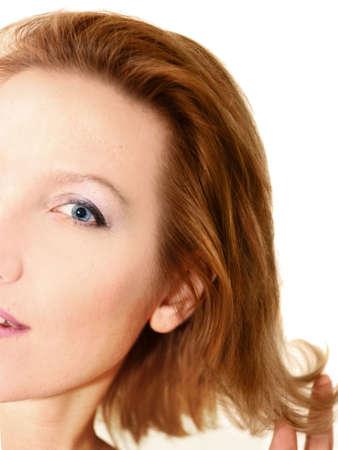 Half woman face over white photo
