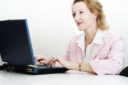 woman working on a laptop computer photo