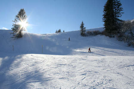 ridgeline: Sunny skiing on Alpine mountainside