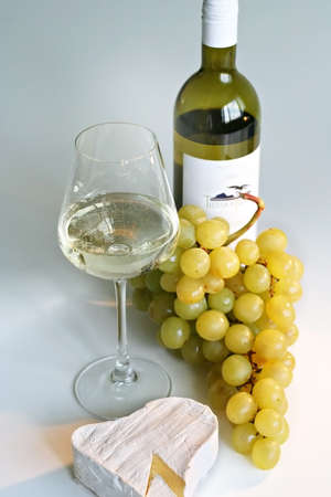 Gold grapes, wine and cheese photo