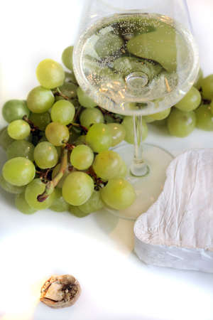 Grapes, wine and cheese photo
