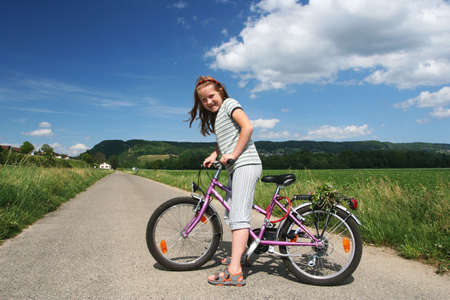 Happy girl with bicycle Stock Photo