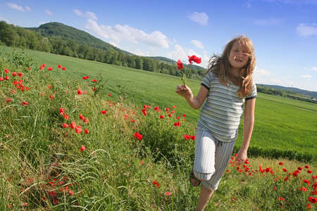 Girl over poppies field Stock Photo - 4254900