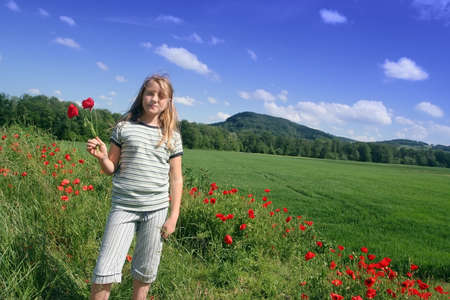 Girl over poppies field Stock Photo