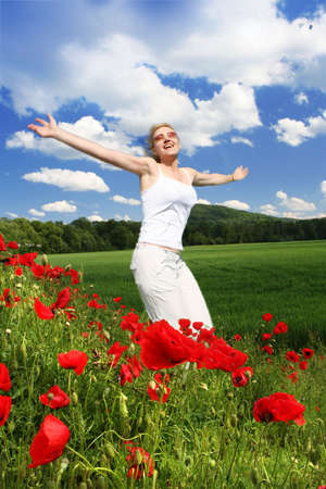 happy woman on the poppies field Stock Photo