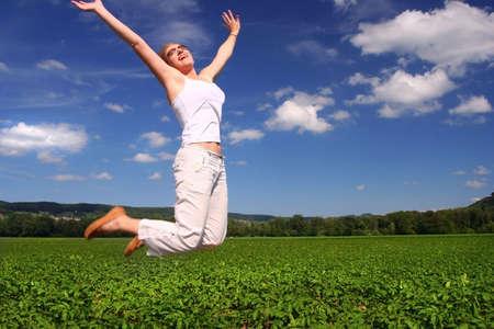 sunny jumping woman photo
