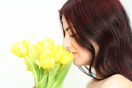 woman with yellow tulips