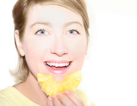 Woman eat pineapple photo