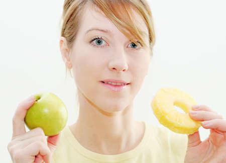 Woman take apple and pineapple photo