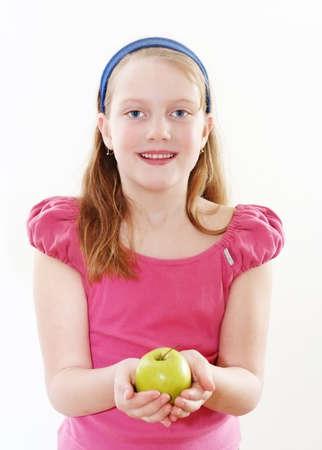 Happy girl with apple photo