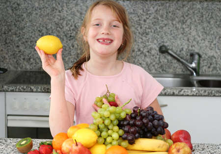 Girl with citrus in the hand Stock Photo