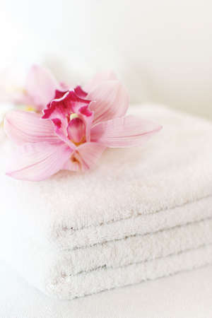 white towels: White towels with orchids
