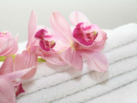 White towels with orchids