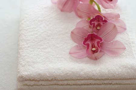 White towels with orchids photo