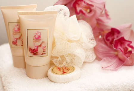 White bath accessories with orchids photo