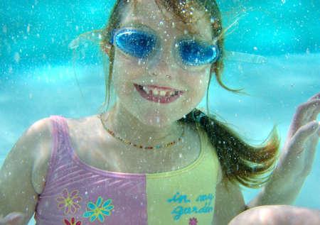 Kid underwater photo