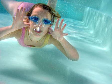 Girl underwater  photo