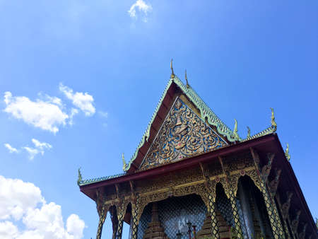 gabled: Gabled roof temple and blue sky in thailand