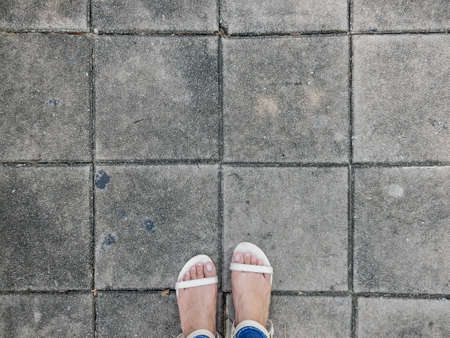 foot wear: foot wear cream color shoes stand on gray cement block Stock Photo