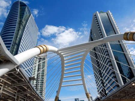 BANGKOK THAILAND - July 26 : Sky bridge link landmark of downtown bangkok between mrt and bts at sathon junction with hight building and blue sky on July 26 , 2016 in Bangkok , Thailand Editorial