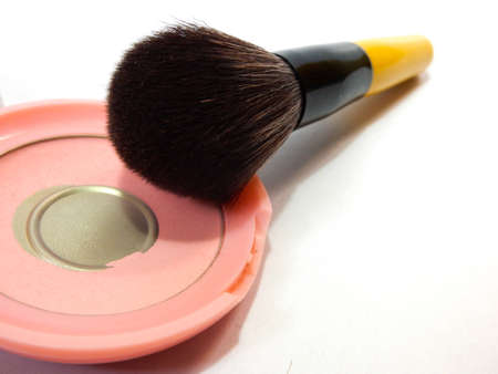 cheek: cosmetic brush on used press pink cheek brush on powder with white background Stock Photo
