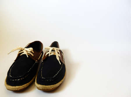 female soles: blue shoes laces on white background Stock Photo