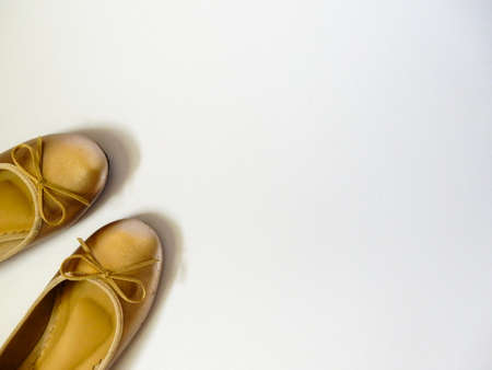 flat shoes: gold flat shoes on white background Stock Photo