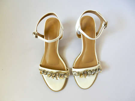 white hight heel shoes with diamond on white background Stock Photo