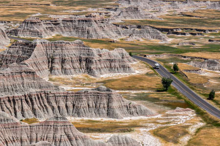 tats: Lonely Campervan in Badlands National Park, South Dakota, USA. Stock Photo